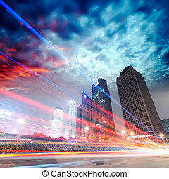 the light trails on the modern building background in...