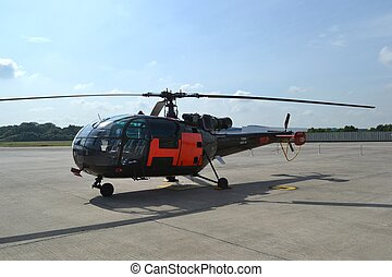 military helicopter on airbase