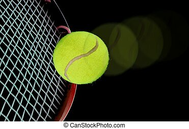 tennis ball and racquet over black