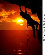 rock climbing during sunset