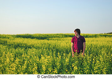 Young Farm Boy in Canola - Young Man in Canola Field