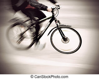 cyclist in blurred motion win vintage sepia style