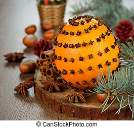 Orange decorated with cloves - Christmas orange decorated...