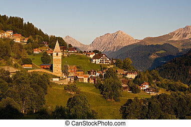 Idyllic alpine village in Switzerland - evening
