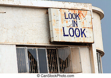 Rundown Look in Look Building - An abandoned building with a...