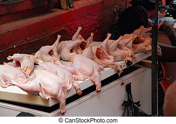 Whole chicken for sale in an open air african market -...