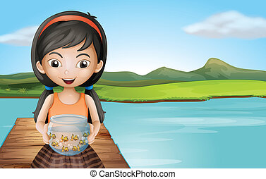 A girl with an aquarium standing at the diving board