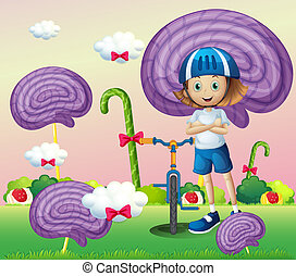 A young female biker surrounded with giant spiral lollipops...