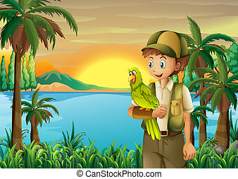 A boy with a parrot at the riverbank