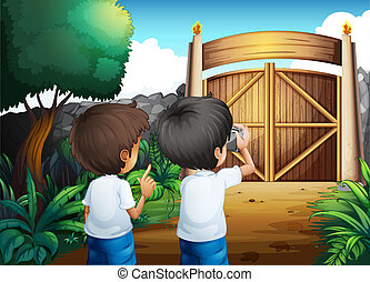 Boys taking pictures inside the gated yard