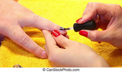 Nail polishing - Visagist making manicure to a model....