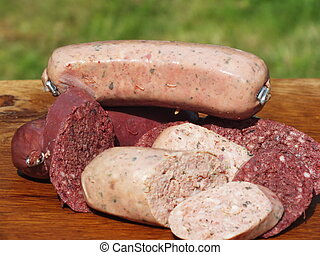blood sausage and liver sausage on a bed of oak