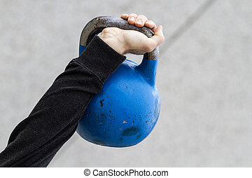 Kettle bell - man holding a kettle bell used for crossfit