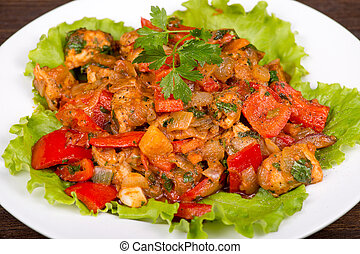 Vegetables with chicken in a curry sauce in white plate