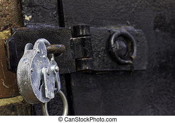 Black Door - A close up of a strong looking silver padlock...