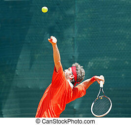 Tennis champion - Young guy is playing a tennis match