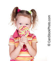 Cute little girl holding big lolly pop isolated in white