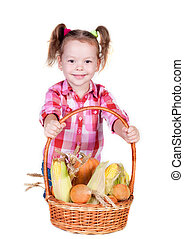 Little girl with basket of vegetables, isolated on white