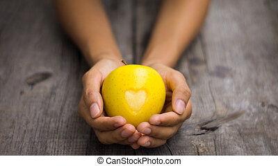 Yellow Apple with engraved heart