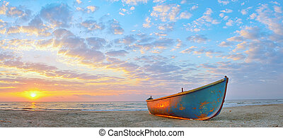 Fishing boat and sunrise on Black Sea beach