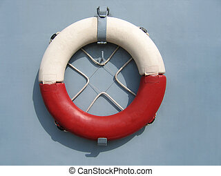Lifebuoy ring - Red and white lifebuoy ring on a wall