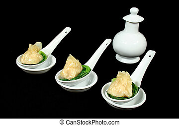 Dim Sums With Soy Sauce - Steamed dim sums with bok choy and...