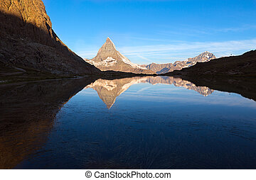Matterhorn reflecton in Riffelsee after sunset, Zermatt,...