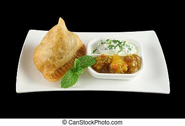 Indian Samosa 1 - Indian samosa with mango chutney and herb...