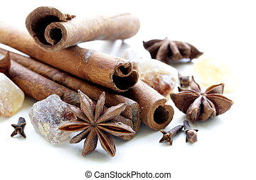 Christmas spices - cinnamon, cloves, star anise on white...