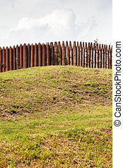 wall from wooden stakes on rampart of old Kremlin in...