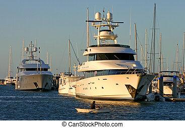Row Boat VS Superyacht - David and Golaith as a dinghy rows...