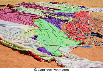 color parachute - big color parachute spread out on sand
