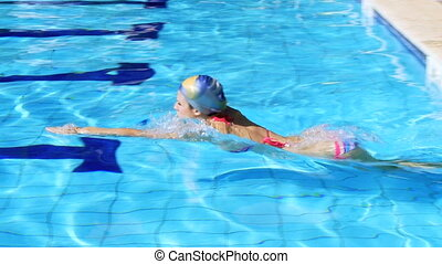 Female swimmer training