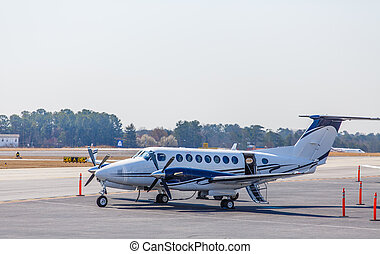 Blue and White Turbo-Prop at Airport - A private turbo-prop...