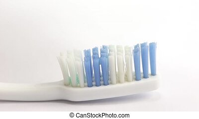 Toothpaste is applied to brush