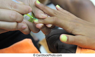 Yellow Paint On Finger Nails - An eleven year old Asian girl...