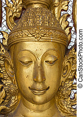 face of golden budda