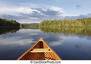 Canoeing on a Tranquil Lake - Bow of a Cedar Canoe on a...