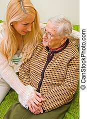 Helping when needed - A young woman talking whit an older...
