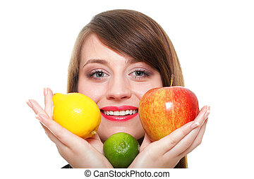 Young smiling woman with fruits and vegetables white...