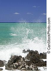 Waves breaking - waves breaking on the rocks