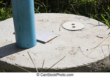 Close-up Septic Cover - sewage system made of cement systems...