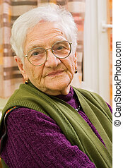 Old woman at home - An old woman\'s portrait at her home.