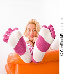 Socks 5 - A young woman sitting on the bed, looking at the...