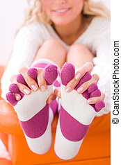 Socks 6 - A young girl sitting on the bed, smiling/laughing,...
