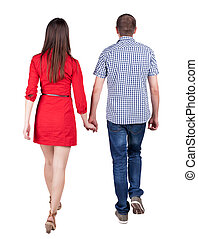 Back view going couple walking friendly girl and guy holding...