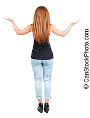 back view redhead young woman with hands up. Girl is bent...