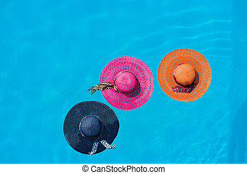 Three hats in the swimming pool