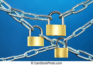 Strong security systems. - Close up of padlocks and chain on...