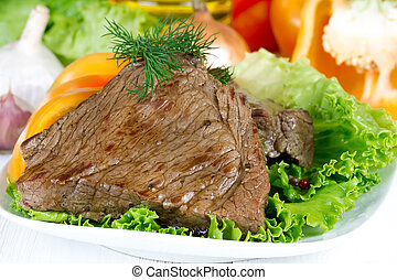 Roast beef   - Roast beef on lettuce leaves with vegetables